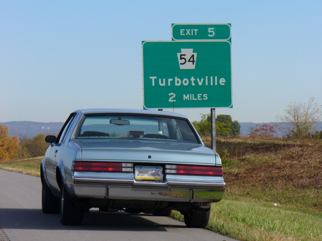 buick turbo t next to turbotville sign