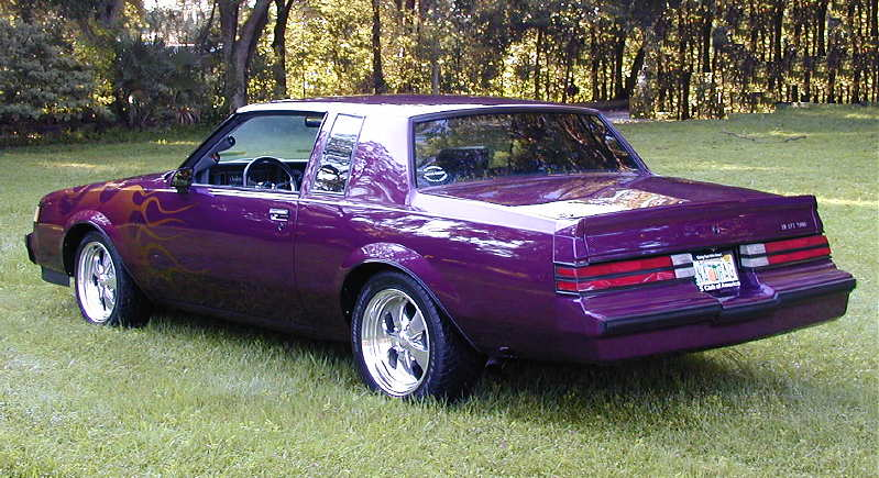 purple buick with flames