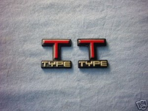 some kind of T TYPE emblems