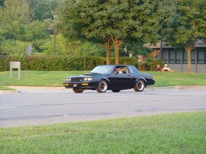 buick grand national driving down the street