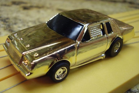 TYCO 440X2 BUICK REGAL GRAND NATIONAL GOLD CHROME