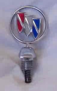 trishield hood emblem